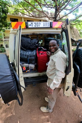 Stowing bags prior to our summiting of Mount Kilimanjaro. Tanzania, Africa