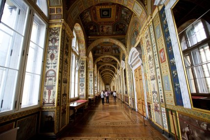 """Commissioned by Empress Catherine II in the late 1780s, the Raphael Loggias are the exact copy of the Gallery in the Papal Palace in Vatican City. The frescoes of the open loggias of the Papal Palace were painted after Raphael's sketches. Their copies made in Italy by a group of artists under the supervision of Christopher Unterberger, took their place in the gallery of a separate building erected by Giacomo Quarenghi. The Loggias vaults are decorated with scenes from biblical stories, the walls are covered with paintings with ornamentation motifs, known as """"grotesques""""."""