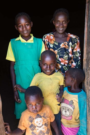 Linda and her mom Violette, along with three of her siblings. Linda has 4 sisters and 3 brothers. She is the big sister and works very hard at her studies and helping her mom take care of their large family. Linda aspires to be a doctor. Viollette is understandably proud of her very bright little girl who's favorite subject is science. Before Madeline School, this family made do with only one meal a day. Now they receive breakfast and lunch as a part of the school program.