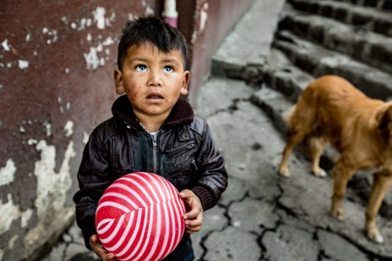 I loved meeting this little boy in Santiago Guatemala as he and his sister played ball