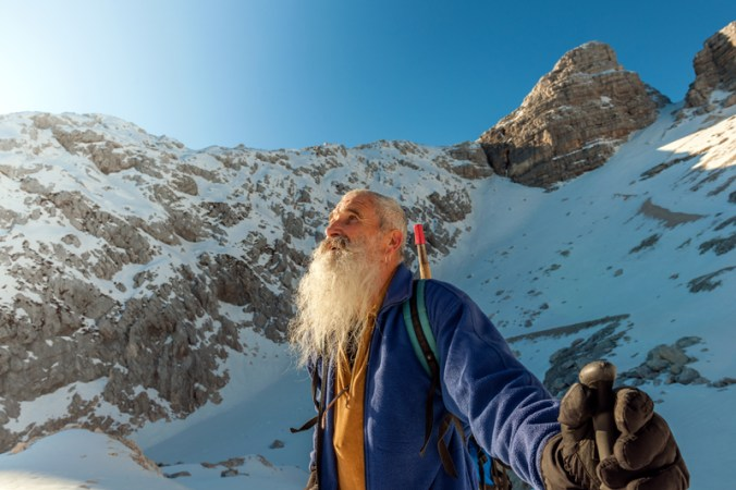 Happy-Senior-Climber-with-Long-Beard,-Kanin,-Julian-Alps,-Europe.-636900410_Copyright iStock
