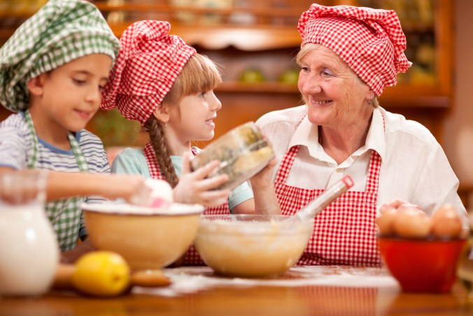 Senior Woman and granddaughter Baking In Kitchen