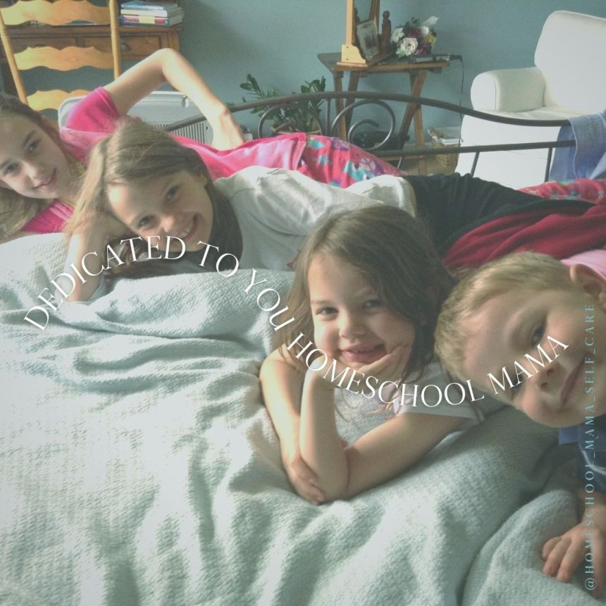 Homeschool kids on a bed