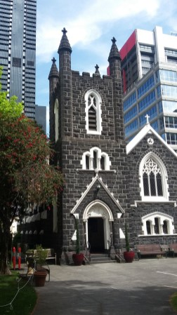 Old church hidden by skyscrapers