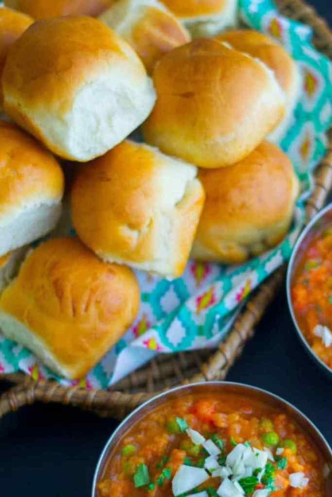 Pav bread on a plate next to the bhaji