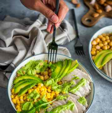 Green Goddess Chicken Salad in a bowl with a fork