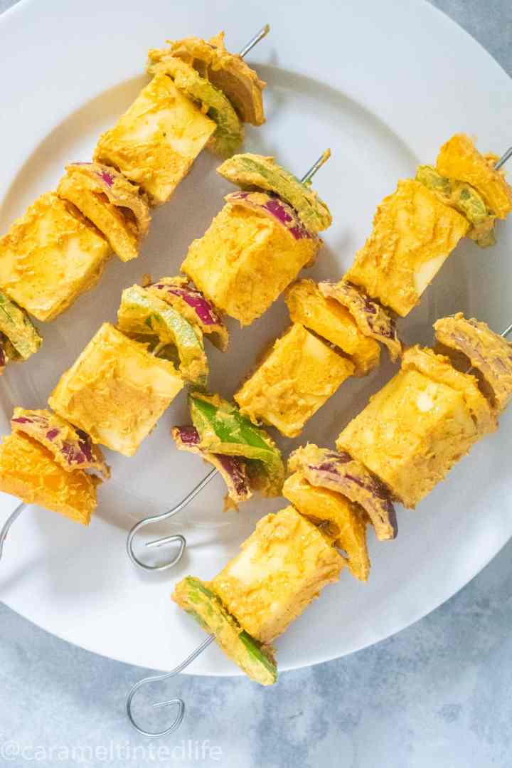 marinated paneer cubes and bell peppers on barbeque skewers
