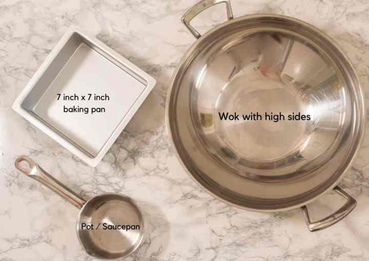 Equipment needed to make mysorepak, including wok, saucepan and baking pan