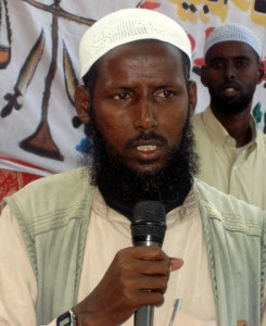 Sheikh Mukhtar Robow, a senior commander of the Islamic courts union, addresses the Al Bayan Islamic courts during its inauguration in Mogadishu July 17, 2006. Islamists who control Mogadishu and a large swathe of southern Somalia have opened a sharia court to serve two government-controlled regions, officials said on Monday. Picture taken July 17, 2006. REUTERS/Shabele Media (SOMALIA)