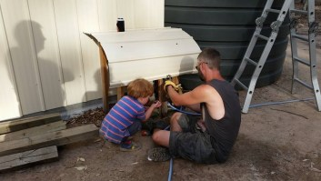 Craig helping Oscar fix things around the block