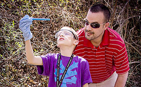 Daniel Tingley helps student conduct water test