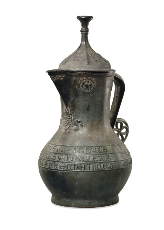 The Asante Jug (Richard II Ewer), manufactured in England, 1390/99, and found at Manhyia Palace, Kumase, Asante region, Ghana. Copper alloy, 62.3 x 33 cm. The British Museum, London, England, 1896,0727.1. Photograph © The Trustees of the British Museum. Shared under a Creative Commons Attribution-NonCommercial- ShareAlike 4.0 International (CC BY-NC-SA 4.0) license This ewer, which was made in England in the 14th century, was taken by the British from Kumase, the capital of the Asante Kingdom, during the Anglo-Asante War of 1896. It is embellished with heraldic motifs and Lombardic inscriptions. The royal arms of England on the front of the jug reference the reigns of both Edward III and Richard II, but the badges on the lid depicting a stag indicate that it was produced during Richard's reign, specifically between 1390 and 1400. The ewer might have traveled across Saharan trade routes soon after it was made, or it might have been imported to Asante at a later time through trade along the Atlantic coast.