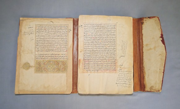 Al-qadi 'Iyad (1083-1149), The Remedy by the Recognition of the Rights of the Chosen One (Al-Shia' bi-ta'rif huquq al-Mustafà). North Africa, Unknown date. Colored and black ink and gold on paper. Institut des hautes études et de recherches islamiques Ahmed Baba, Timbuktu, Mali, 165. Born in Cueta, on the northernmost coast of Morocco across from Gibraltar, the scholar al-qadi 'Iyad wrote a biography of the Prophet Mohammad with devotional instructions in the 12th century. This is likely a later copy produced in North Africa. It was imported across the Sahara at an unknown time and is one of about 40,000 manuscripts in the collection of Mali's Ahmed Baba Institute, most acquired from private family libraries in centers of Islamic learning across Mali.