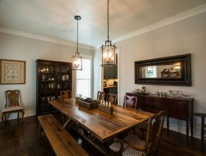 Large wooden dining table with benches