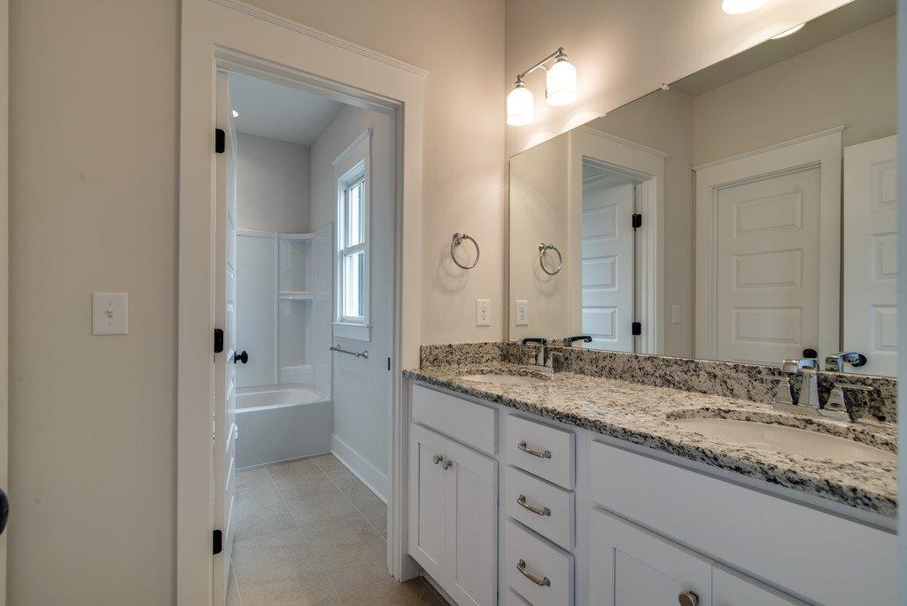 New Home Custom Jack & Jill Bathroom in Tollgate Village by Carbine & Associates
