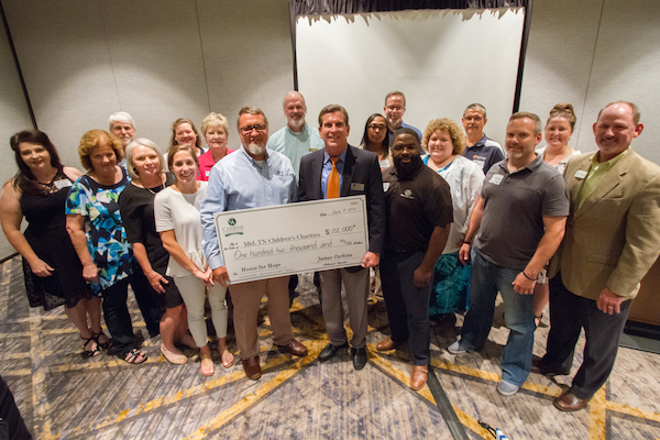 Carbine-And-Associates-Donates-$102,000-To-Charity