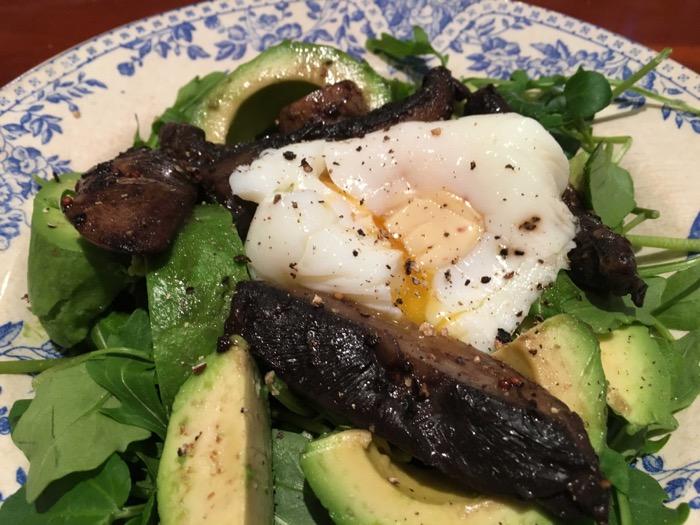Poached egg with Portobello mushrooms, avocado and peppery salad