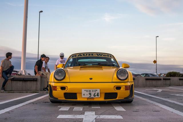 "RWB Porsche 964 nicknamed ""Qeema"" in yellow, front view"