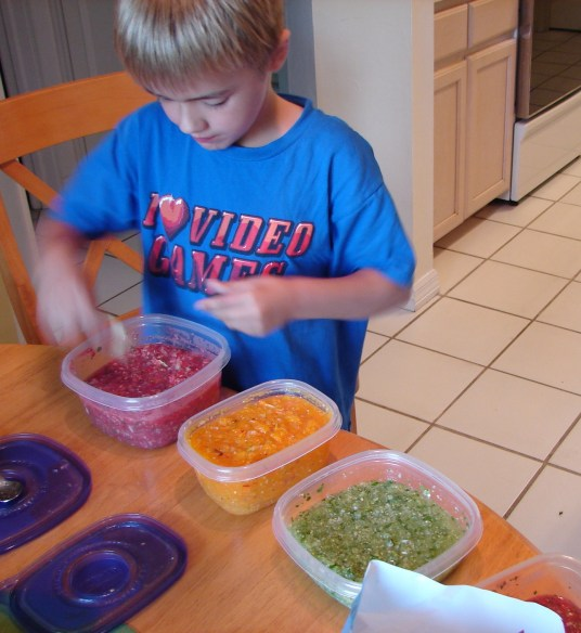 My son John enjoying red, yellow, green salsa.