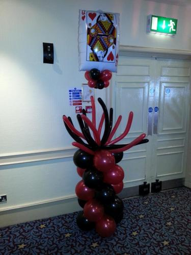 Spider topped pillar with giant floating playing card at The Angel Hotel Cardiff
