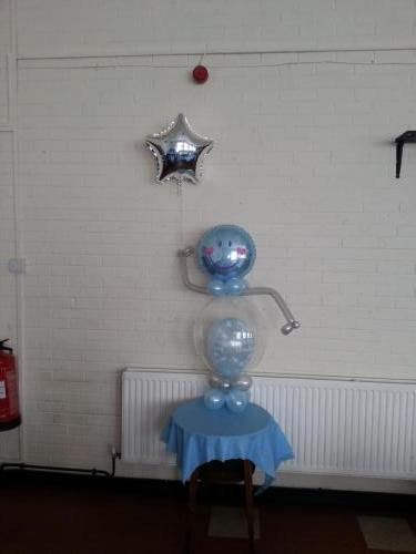 Bubble Man Holding A Personalised Foil For A Christening In Cardiff