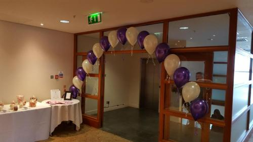 String Of Pearl Arch In Stunning Purple And Ivory at St Davids Hotel And Spa
