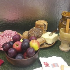 Authentic snacks including plums, apples, cheeses, pies and salami