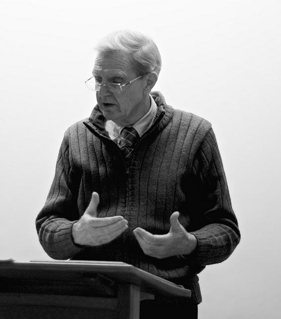 M. Wynn Thomas speaking on stage.