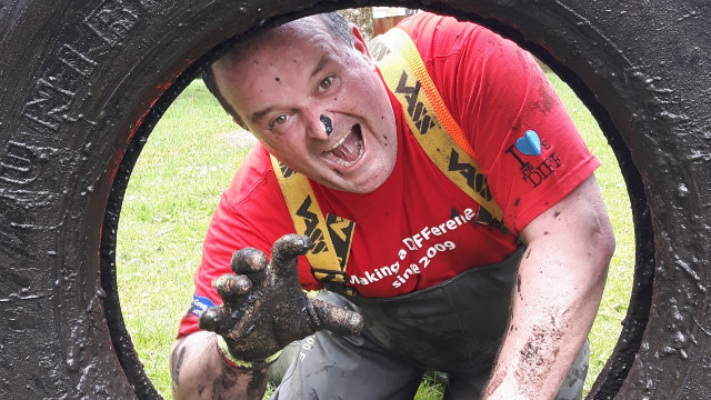 Chris Hackett looking through a lorry tyre