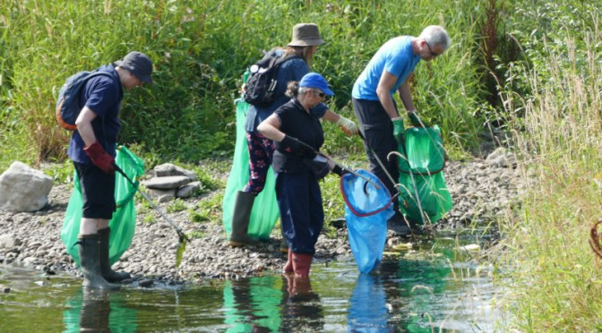 People litterpicking at Blackweir