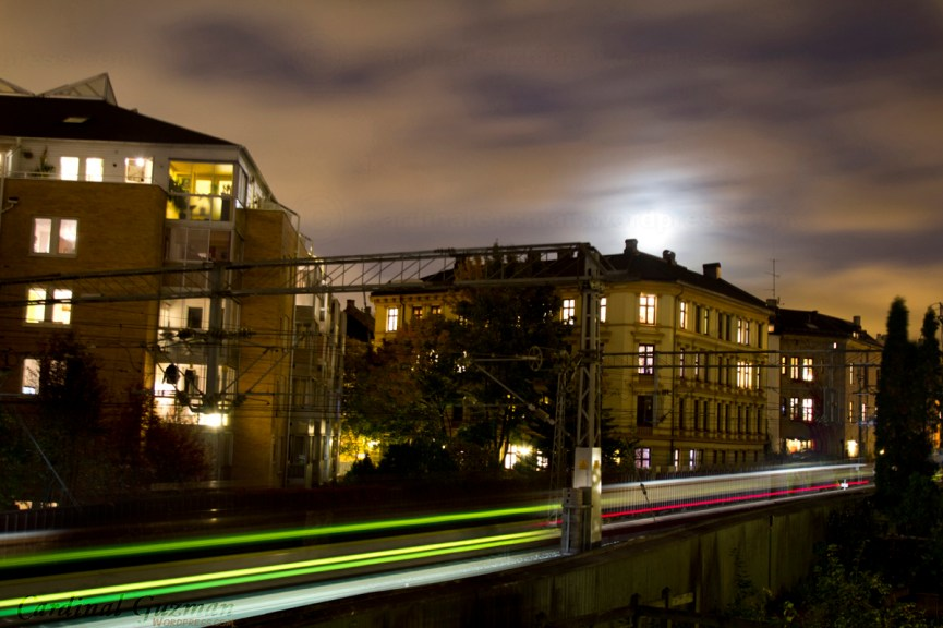 Light trails from two trains passing by.