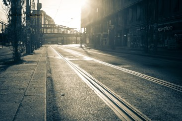Tram line in low morning sun. Duo tone.