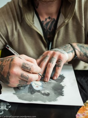 Jacub Hendrix working on a drawing.