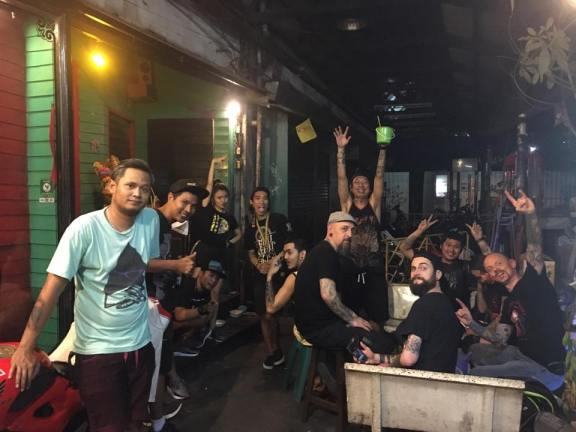 Party in the backstreets of Bangkok. Photo: Sax Tattoo Shop