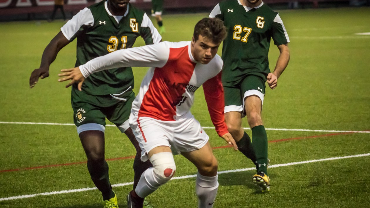 Junior forward Chris Robertson carries the ball through the Clarkson defence during their game last Saturday. The Cards went on to defeat the Golden Knights 2-0