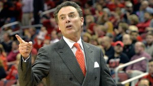 Louisville head coach Rick Pitino shouts instructions to his team during the first half of an NCAA college basketball game Monday, Nov. 24, 2014, in Louisville, Ky. (AP Photo/Timothy D. Easley)