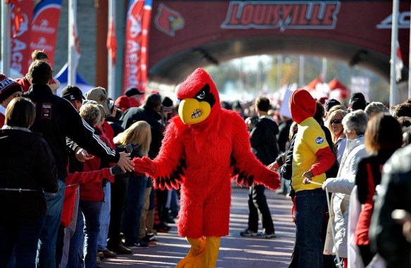 Nov 14, 2015; Louisville, KY, USA; The Louisville mascot greets fans during the Card March before facing off against the Virginia Cavaliers at Papa John's Cardinal Stadium. Mandatory Credit: Jamie Rhodes-USA TODAY Sports