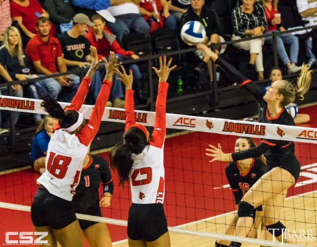 Amanda Green (#18) and Jasmine Bennett (#25) attempt to block a WKU hitter