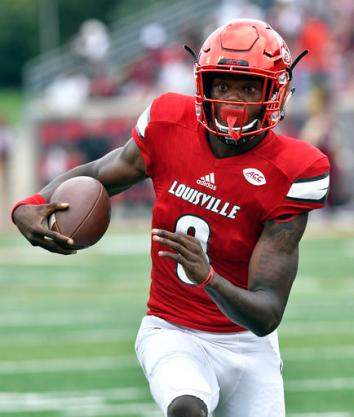 FILE - In this Sept. 17, 2016, file photo, Louisville's Lamar Jackson runs through an opening in the Florida State line during the first quarter of an NCAA college football game, in Louisville Ky. Lamar Jackson and No. 3 Louisville go from playing the main event last week to the side stage this week. The Cardinals head to Marshall after jumping into the national title race by tearing up Florida State at home last week. (AP Photo/Timothy D. Easley, File)