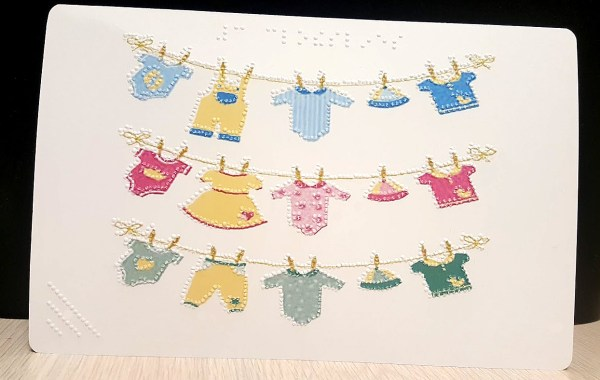 New Baby Card - Baby clothes hanging on drying rack