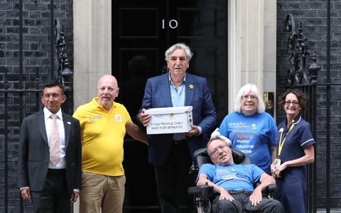 Downton Abbey actor delivers petition urging benefit changes for terminally ill