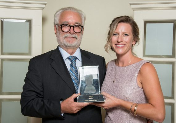 Winner: David Dare, Roads'End Contracting (L) and Jenny Martin, 2019 CARE Awards Chair and VRBA President