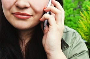 picture of a woman making a cell phone call