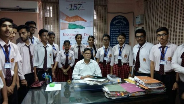 Income Tax Officer Mr. Rajesh Patwal & 10+2 Commerce students.