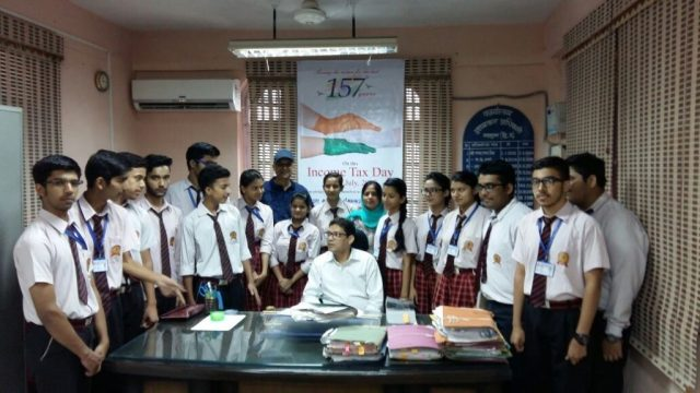 Income Tax Officer Mr. Rajesh Patwal and Mr.Income Tax Commissioner Mr. Vikramjeet interacting with the students.