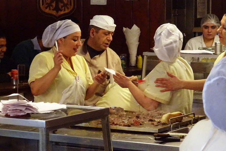 Chefs at work in Fuente Alemana's busy open kitchen