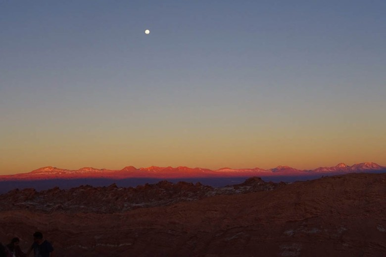 The moon hanging over Valle de la Luna just after sunset