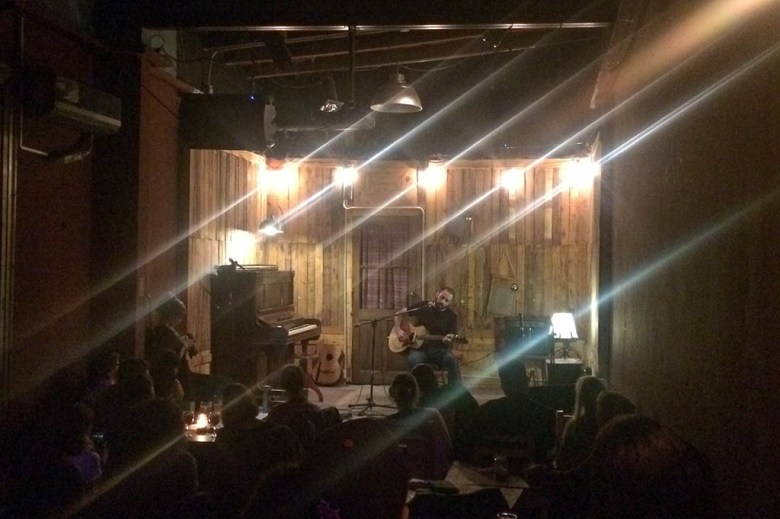 A local singer-songwriter performing at El Universal's open folk night