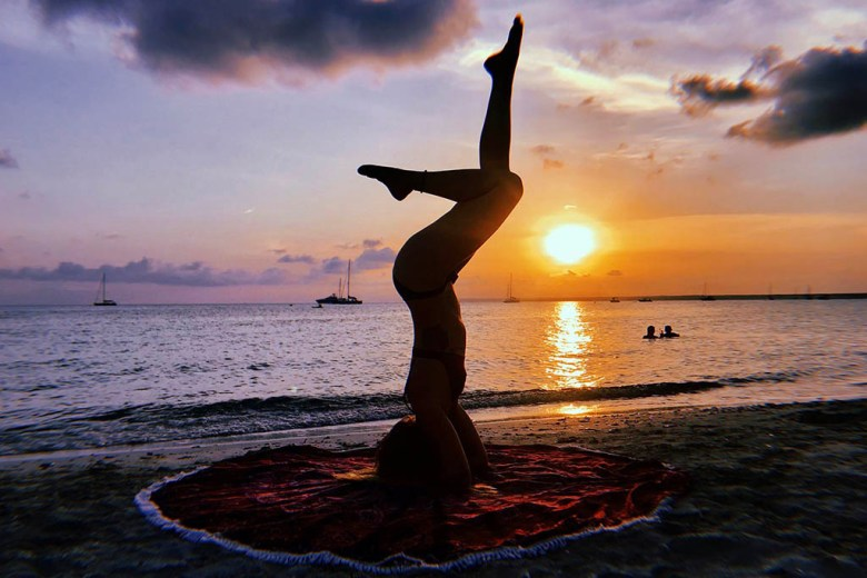 Michaela practicing yoga in Mallorca, Spain