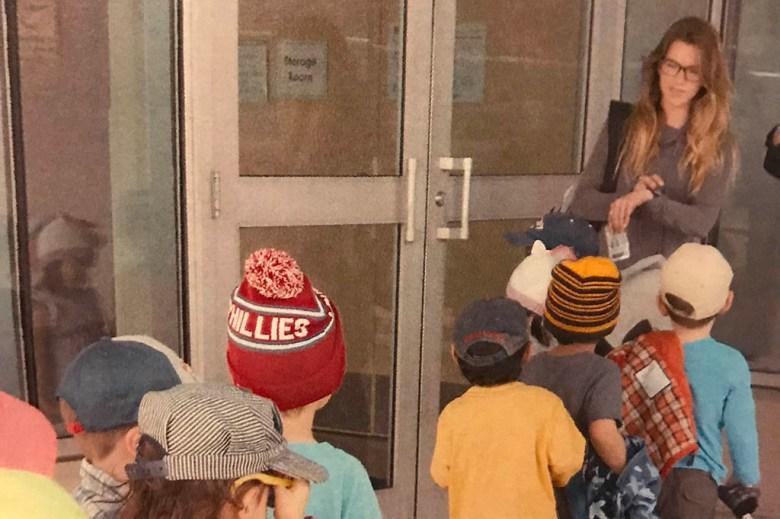 Michaela in her job as a preschool teacher before she quit to travel
